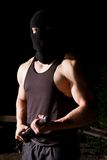 Gangster with baton outdoors at night Stock Photo