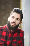 Gangster with beard and piercings Stock Images