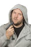 Gangster blowing on handgun Stock Photo