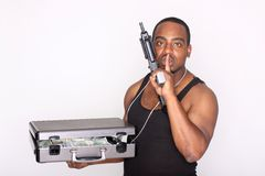 Gangster with cash and gun Royalty Free Stock Image