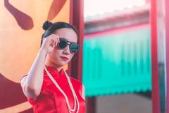 Gangster chinese woman wearing sunglasses as a boss. Gangster style chinese woman wearing sunglasses as a boss stock images