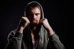 Gangster with clenched fists looking at the camera. Martial art.self-defence.resounding blow Stock Image
