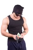 Gangster counting money Royalty Free Stock Photography