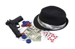Gangster gambling kit. With a black pinstriped Fedora, money, poker chips, and a gun - path included Stock Photography