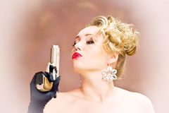 Gangster girl. Portrait with gun , picture in retro style stock image