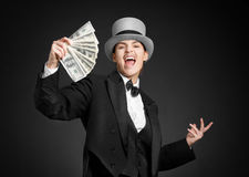 Gangster girl keeps money in hands Royalty Free Stock Photography