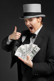 Gangster girl keeps money in hands. And showing OK sign Stock Photography
