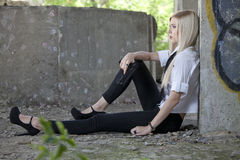 Gangster girl resting on the ground royalty free stock photo