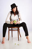 Gangster-girl sitting on chair Royalty Free Stock Photo