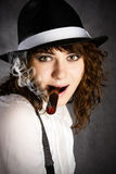 Gangster girl smoking cigar Stock Photo