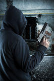 Gangster with gun at night. Gangster with gun in ghetto at night royalty free stock image