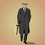 Gangster with gun walking pop art style vector Royalty Free Stock Photography
