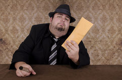 Gangster holding brown envelope Royalty Free Stock Photography