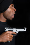 Gangster Holding Gun Stock Photography
