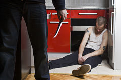 Gangster With Knife. And His Victim royalty free stock image
