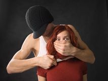 Gangster with knife and his victim Royalty Free Stock Photography