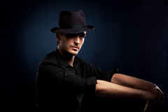 Gangster look. Man with hat and cigar. Royalty Free Stock Photography