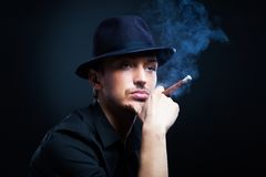 Gangster look. Man with hat and cigar. Royalty Free Stock Photo