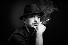 Gangster look. Man with hat and cigar. Stock Photos