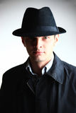 Gangster man in hat looking in camera Stock Image