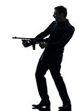 Gangster man holding thompson machine gun silhouette Stock Photography