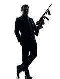 Gangster man holding thompson machine gun silhouette Royalty Free Stock Images