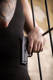 Gangster man standing and holding gun. Stock Photos