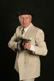 Gangster man in suit with gun Royalty Free Stock Photos