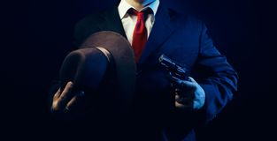 Gangster man in suit with gun. royalty free stock image