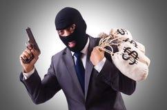 Gangster med påsar av pengar arkivbild
