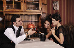 Gangsters man and two women. Royalty Free Stock Image
