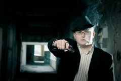 Gangster with pistol in abandoned house background Stock Photo