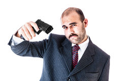 Gangster. Portrait of a classy businessman or mobster or security guard holding a gun isolated over a white background stock image