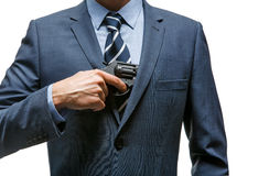 Gangster pulls out a gun Royalty Free Stock Images