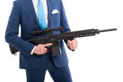 Gangster or secret agent with machine gun. Gangster or secret agent with tactical machine gun on white background Royalty Free Stock Photo