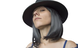 Gangster woman with hat and black hair. On white background royalty free stock image