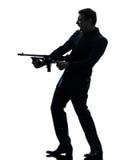 Gangstermann, der Thompson-Maschinengewehrschattenbild hält Stockfotografie