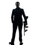 Gangstermann, der Thompson-Maschinengewehrschattenbild hält Lizenzfreie Stockfotos
