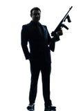 Gangstermann, der Thompson-Maschinengewehrschattenbild hält Stockfotos