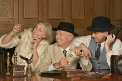 Gangsters companions on the table Royalty Free Stock Photos