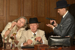 Gangsters companions on table Stock Photography