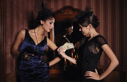 Gangsters girls divide the money. Picture in retro style stock images