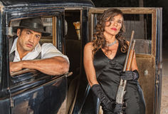 Gangsters with Shotgun in Car. Tough male and female gangsters with shotgun in car Stock Photos