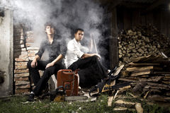 Gangsters and smoke. Are sitting in the yard Royalty Free Stock Photography