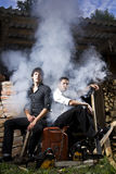 Gangsters and smoke. Are sitting in the yard Royalty Free Stock Photos