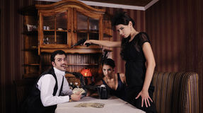 Gangsters who share the money,. Women wants to shoot the guy Royalty Free Stock Images