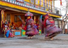 Monks perform masked and costumed dance of Tibetan Buddhism during the Cham Dance Festival. Dancers blurred motion stock photos
