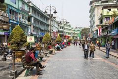 Gangtok, India, March 8 2017: People walking and rest in the Public park. On the middle of the Mahatma Gandhi street Stock Image