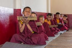 Lesson for novice monks in buddhist Tsuglakhang monastery in Gangtok, India. Gangtok, India - May 3, 2017: Lesson for novice monks in buddhist Tsuglakhang royalty free stock photography