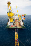 Gangway between barge and oil and gas platform, worker walked passed the way for work on the platform Stock Photography